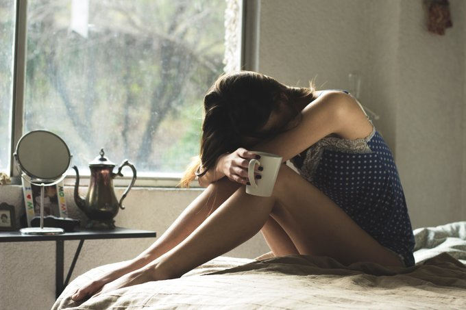 Conquer your fear of rejection, woman sitting in bed, woman sad in room, criticism, abusybeeslife