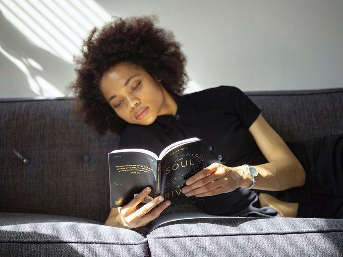ebony woman, woman reading a book, woman reading on sofa, abusybeeslife