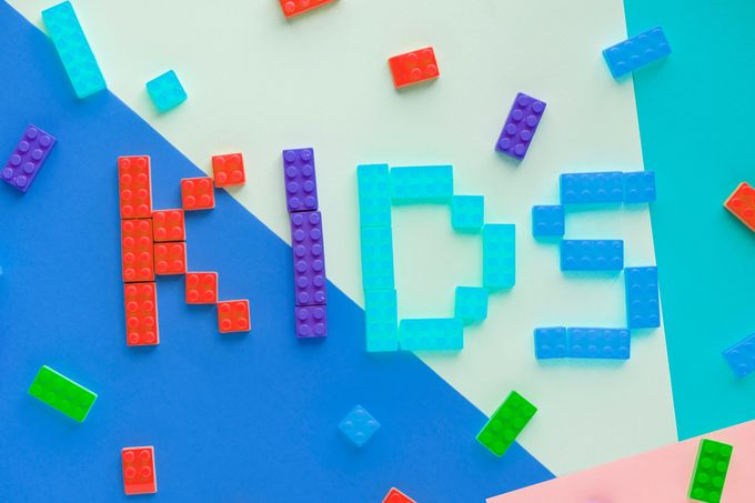 different coloured kids lego blocks spell out the word kids