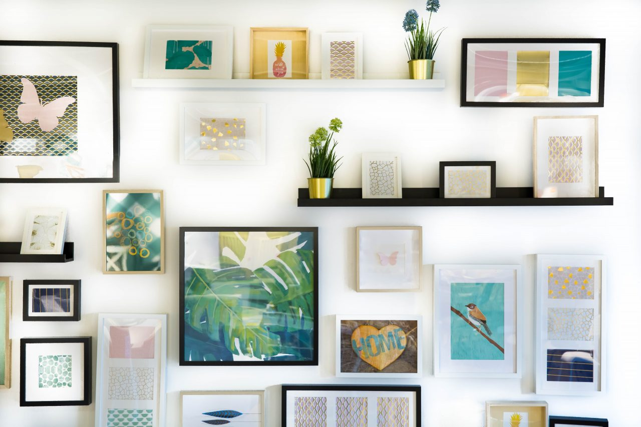 home decor picture frames on wall from floor to ceiling
