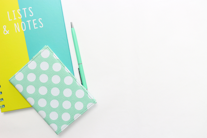 Rebranded my blog to Purposeful Habits, green book for lists and notes, plus small polka dot journal on white background