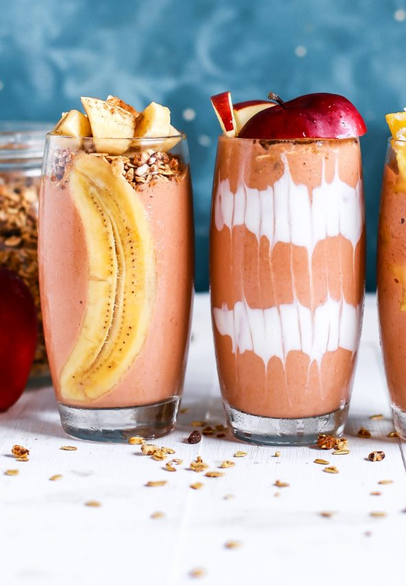 Smoothie and fruit in tall glasses